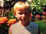 A young, blonde Macklin in the rose garden.