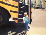 Amelia as a kindergartener getting on the school bus.