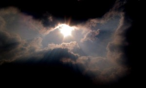Heavenly cloud with sun in sky.