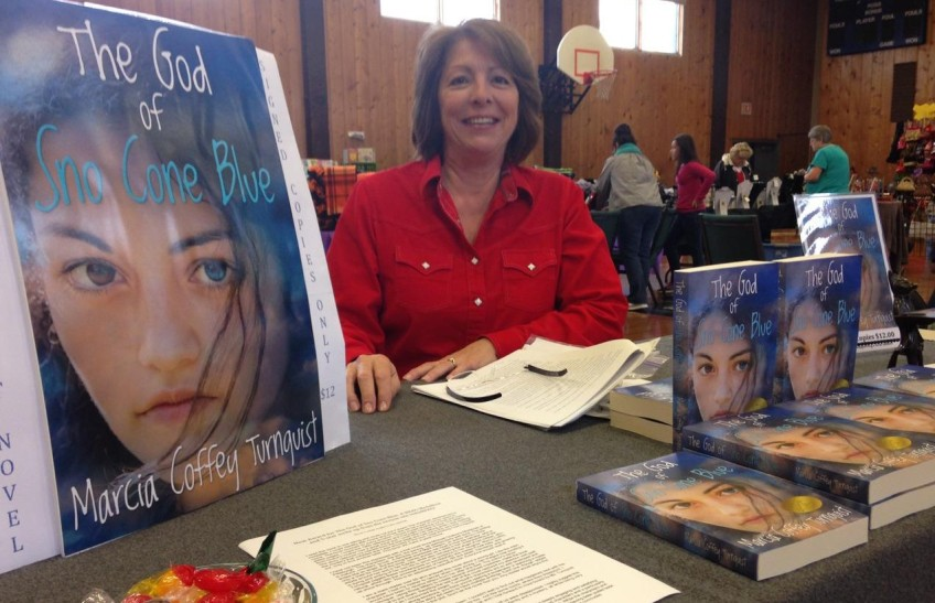 Marcia at a holiday market with her books.