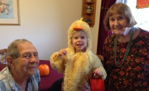 Clayton and Hazel with trick or treater.