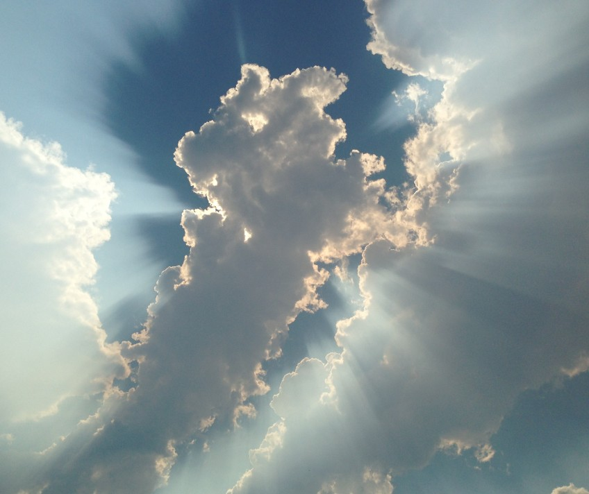 Clouds with sun shining through.
